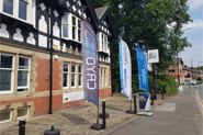 CRYONiQ showroom seen from street with banners with cryotherapy chamber for sale in UK Manchester